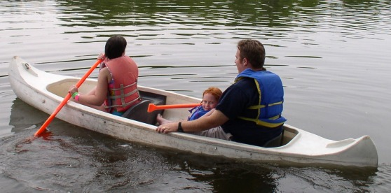 Melissa, Lydia and Dad in the canoe
